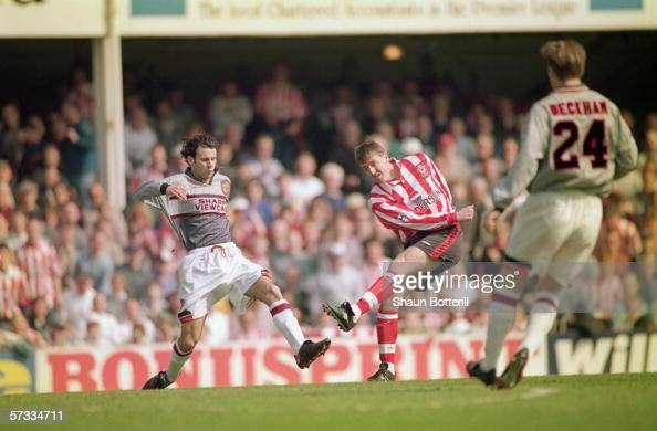 Matthew Le Tissier of Southampton shoots at goal as Ryan Giggs of Manchester United makes a challenge during the FA Carling Premiership match between...
