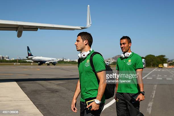 Matthew Leckie and Mark Birighitti of the Socceroos walk along the tarmac to their charter flight to Salvador at Vitoria Airport on June 5 2014 in...
