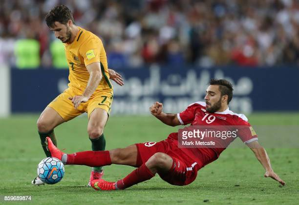 Matthew Leckie of Australia and Mardek Mardkian of Syria compete for the ball during the 2018 FIFA World Cup Asian Playoff match between the...