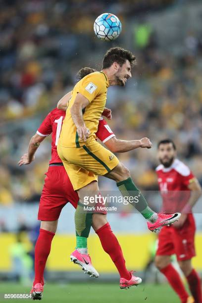 Matthew Leckie of Australia wins a header during the 2018 FIFA World Cup Asian Playoff match between the Australian Socceroos and Syria at ANZ...