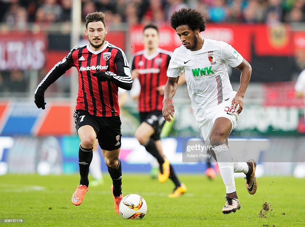 Matthew Leckie of Ingolstadt 04 challenges Caiuby of Augsburg during the Bundesliga match between FC Ingolstadt and FC Augsburg at Audi Sportpark on February 6, 2016 in Ingolstadt, Germany.