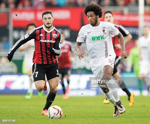 Matthew Leckie of Ingolstadt 04 challenges Caiuby of Augsburg during the Bundesliga match between FC Ingolstadt and FC Augsburg at Audi Sportpark on...