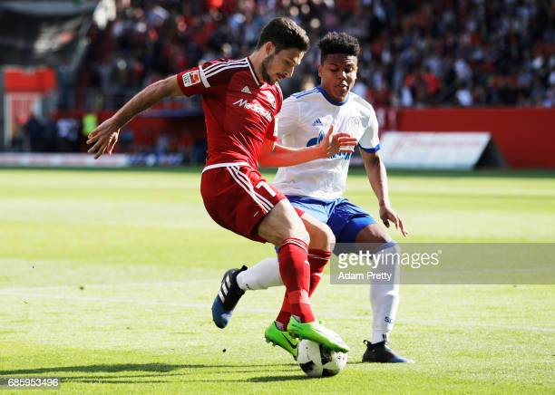 Matthew Leckie of Ingolstadt 04 is challenged by Weston McKennie of Schalke 04 during the Bundesliga match between FC Ingolstadt 04 and FC Schalke 04...