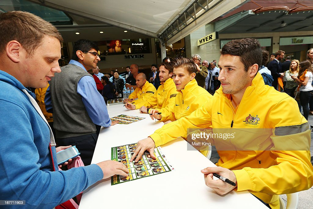Matthew Leckie signs autographs for fans during an Australian Socceroos public appearance at Westfield Sydney on November 12, 2013 in Sydney, Australia.