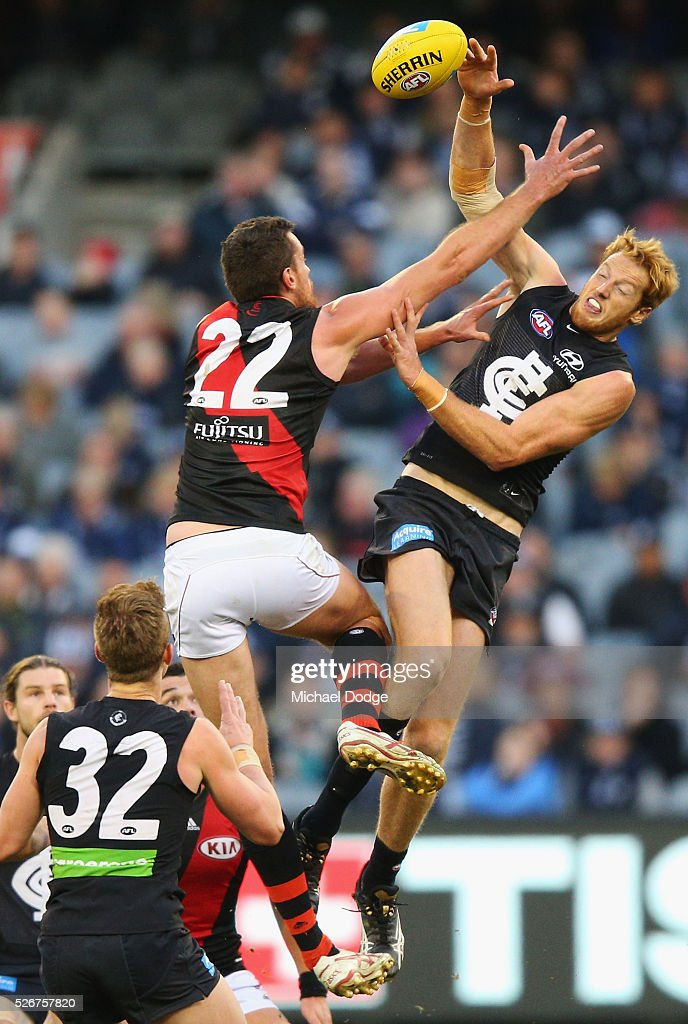Matthew Leuenberger of the Bombers (L) and Andrew Phillips of the Blues compete for the ball during the round six AFL match between the Carlton Blues and the Essendon Bombers at Melbourne Cricket Ground on May 1, 2016 in Melbourne, Australia.