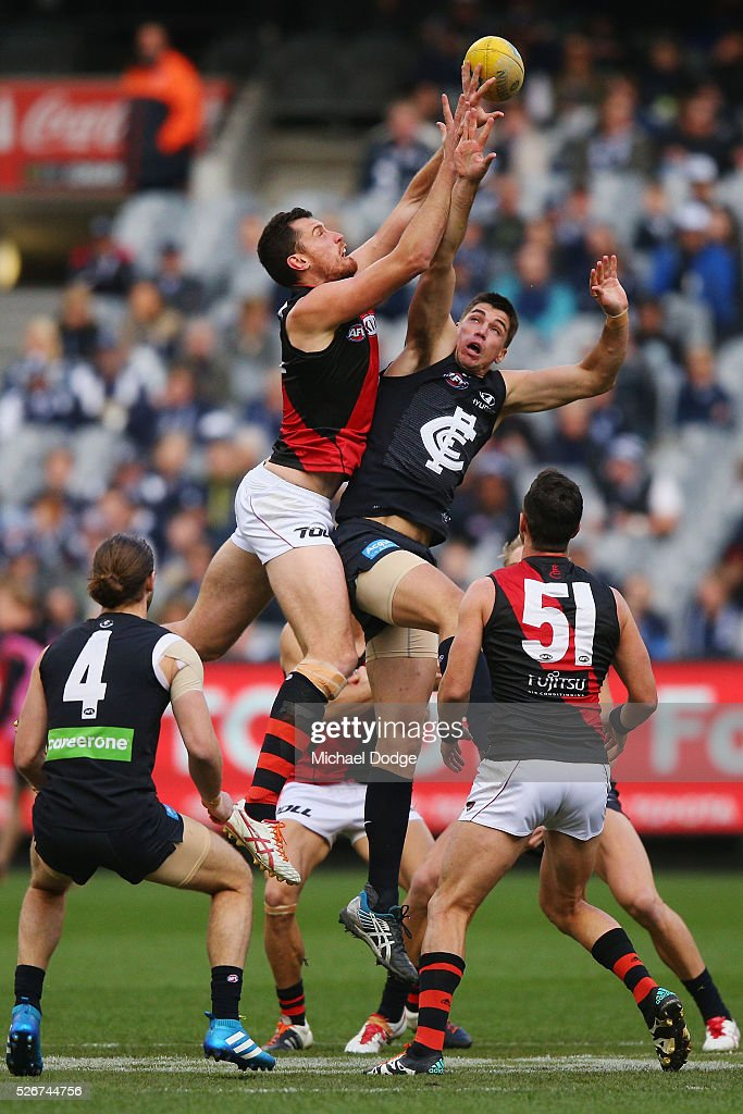 Matthew Leuenberger of the Bombers (L) and Matthew Kreuzer of the Blues compete for the ball during the round six AFL match between the Carlton Blues and the Essendon Bombers at Melbourne Cricket Ground on May 1, 2016 in Melbourne, Australia.