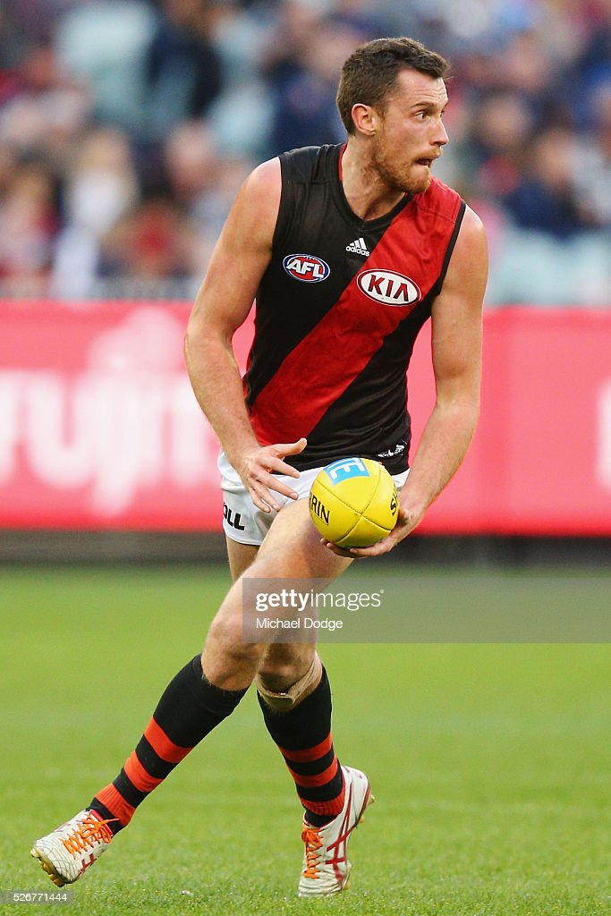 Matthew Leuenberger of the Bombers looks upfield during the round six AFL match between the Carlton Blues and the Essendon Bombers at Melbourne Cricket Ground on May 1, 2016 in Melbourne, Australia.