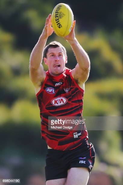 Matthew Leuenberger of the Bombers marks the ball during an Essendon Bombers AFL training session at True Value Centre on June 20 2017 in Melbourne...