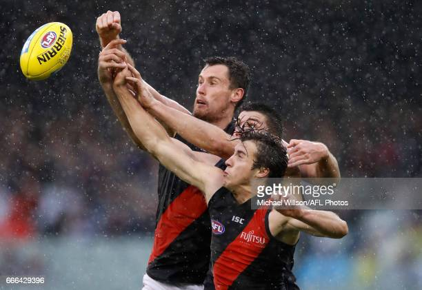 Matthew Leuenberger of the Bombers Matthew Kreuzer of the Blues and Andrew McGrath of the Bombers compete for the ball during the 2017 AFL round 03...