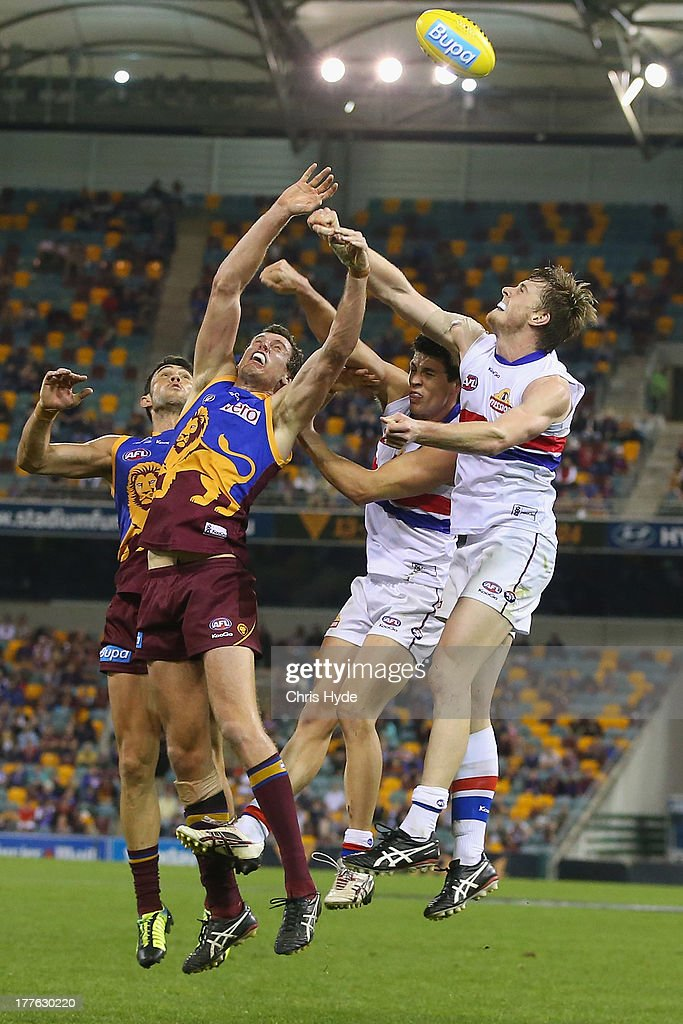 Matthew Leuenberger of the Lions and Jordan Roughhead of the Bulldogs compete for the ball during the round 22 AFL match between the Brisbane Lions and the Western Bulldogs at The Gabba on August 25, 2013 in Brisbane, Australia.