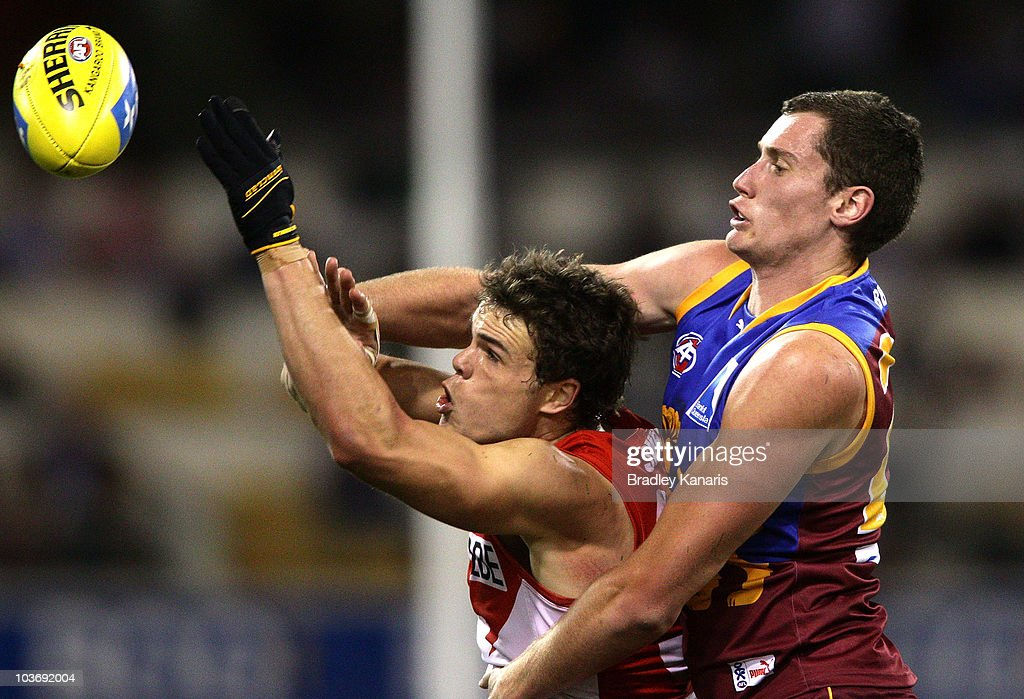 Matthew Leuenberger of the Lions and Mike Pyke of the Swans challenge for the ball during the round 22 AFL match between the Brisbane Lions and the Sydney Swans at The Gabba on August 28, 2010 in Brisbane, Australia.