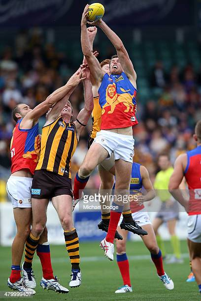 Matthew Leuenberger of the Lions marks the ball against David Hale of the Hawks during the round one AFL match between the Hawthorn Hawks and the...