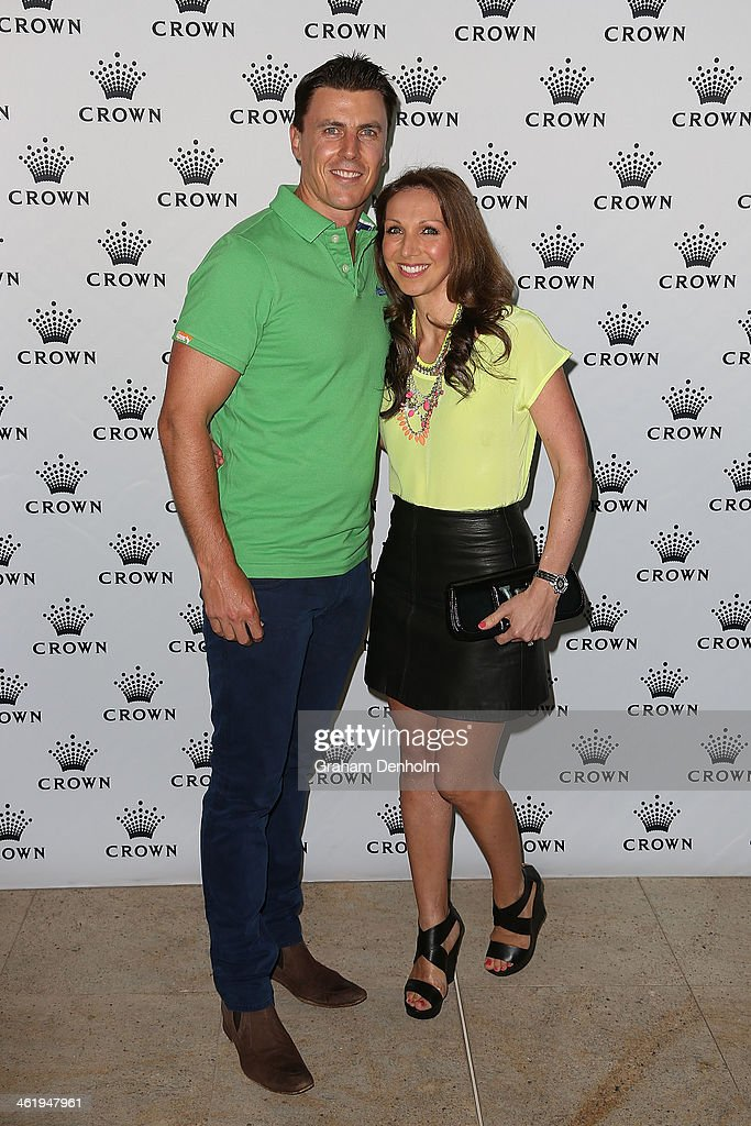 Matthew Lloyd and his wife Lisa Lloyd arrive at the IMG tennis players party at Crown Towers on January 12 2014 in Melbourne Australia
