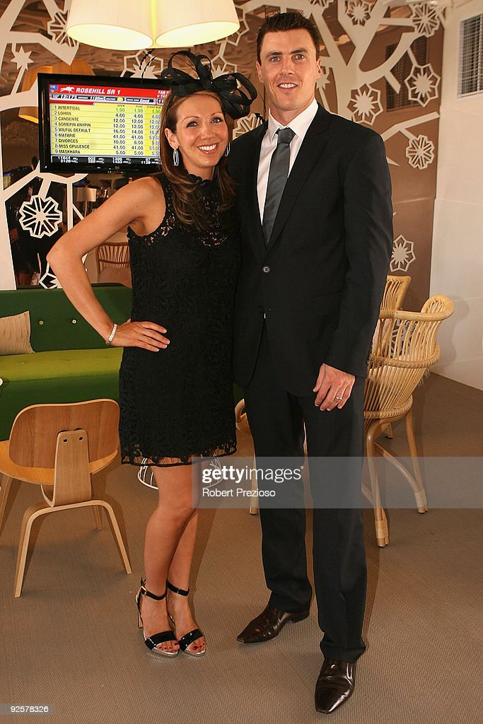 Matthew Lloyd and wife Lisa poseat the AAMI Victoria Derby Day at Flemington Racecourse on October 31 2009 in Melbourne Australia