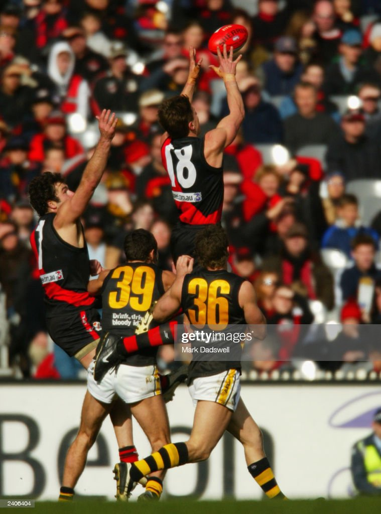 Matthew Lloyd for the Bombers marks over his opponents during the round 20 AFL match between the Essendon Bombers and the Richmond Tigers at the MCG...