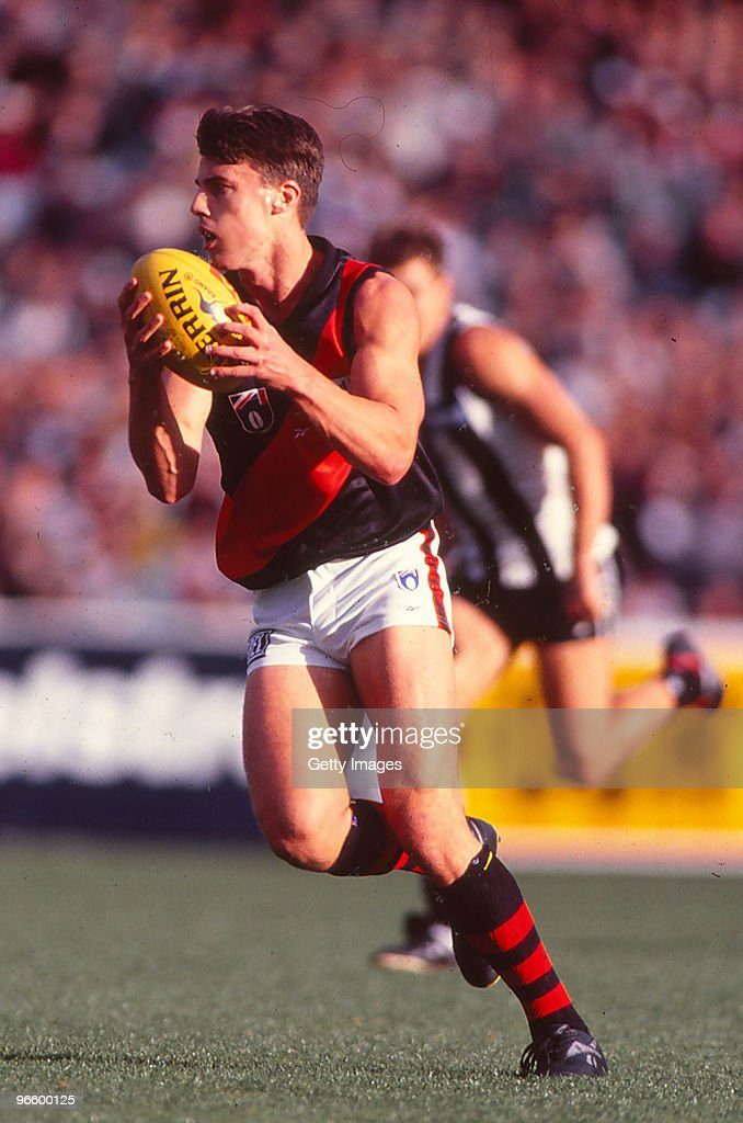 Matthew Lloyd of the Bombers catches the ball during the round five AFL match between the Essendon Bombers and the Collingwood Magpies at the MCG in...