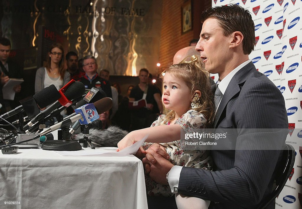 Matthew Lloyd of the Bombers is seen with his daughter Jaeda as he talks to the media to announce his retirememnt from AFL football at Windy Hill on...