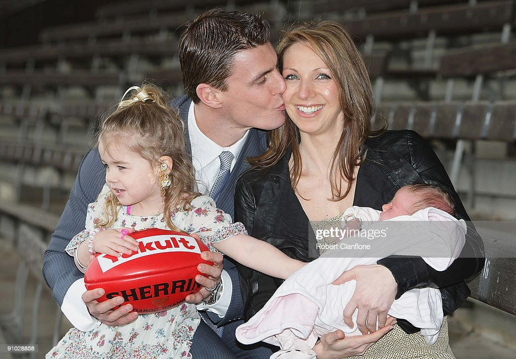 Matthew Lloyd of the Bombers poses with his wife Lisa and duaghters Jaeda and Kira after announcing his retirememnt from AFL football at Windy Hill...