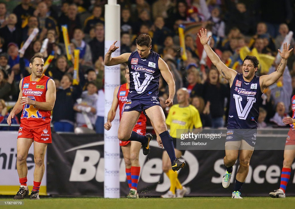 Matthew Lloyd of Victoria celebrates after kicking a goal during the EJ Whitten Legends AFL game between Victoria and the All Stars at Etihad Stadium...