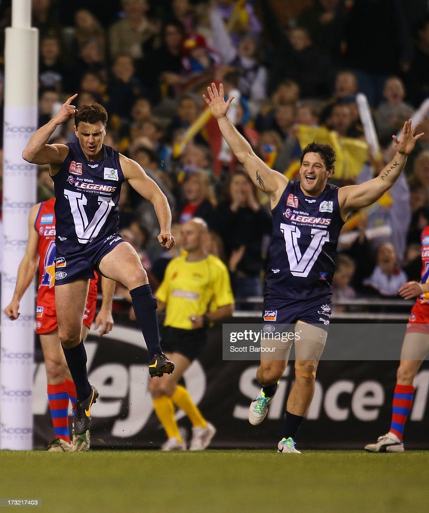 <a gi-track='captionPersonalityLinkClicked' href=/galleries/search?phrase=Matthew+Lloyd&family=editorial&specificpeople=171673 ng-click='$event.stopPropagation()'>Matthew Lloyd</a> (L) of Victoria celebrates after kicking a goal during the EJ Whitten Legends AFL game between Victoria and the All Stars at Etihad Stadium on July 10, 2013 in Melbourne, Australia.