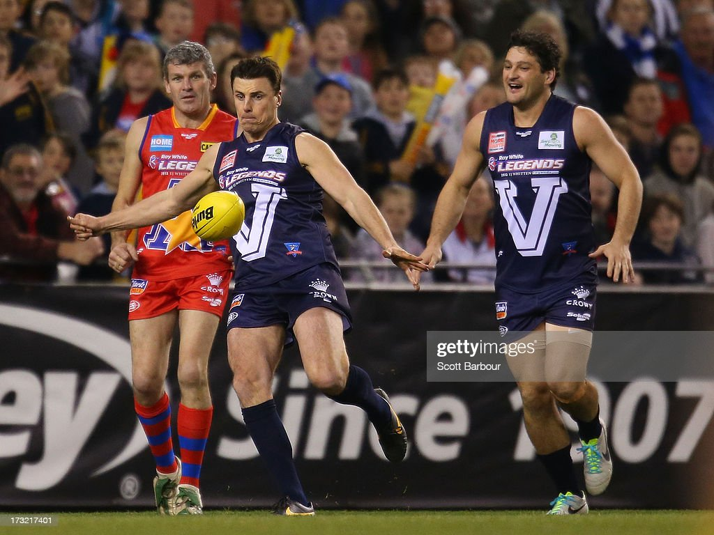 Matthew Lloyd of Victoria kicks a goal during the EJ Whitten Legends AFL game between Victoria and the All Stars at Etihad Stadium on July 10 2013 in...