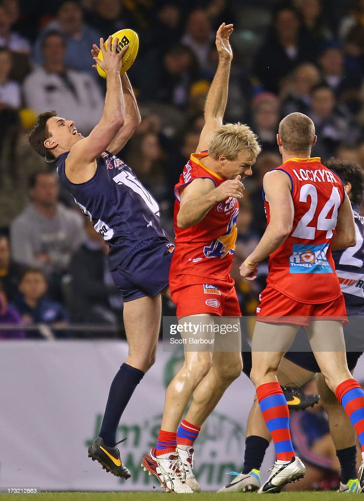 Matthew Lloyd of Victoria takes a mark during the EJ Whitten Legends AFL game between Victoria and the All Stars at Etihad Stadium on July 10 2013 in...