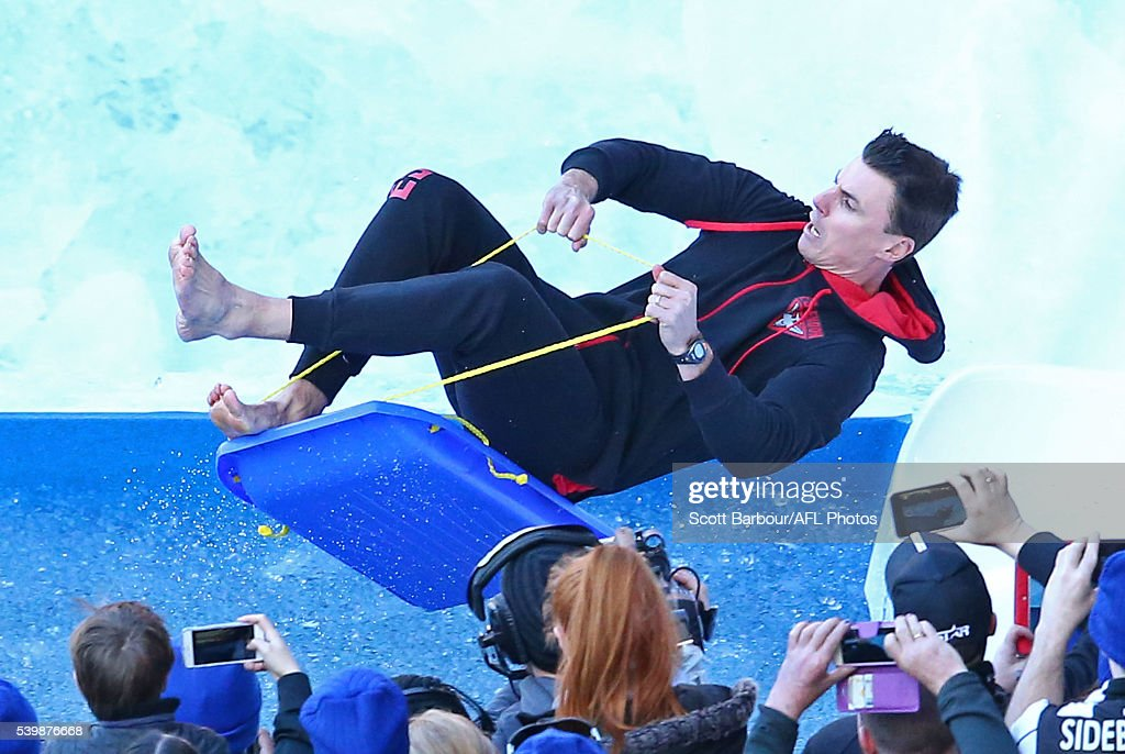 Matthew Lloyd slides in the The Big Freeze 2 Celebrity Challenge during the The Big Freeze at the G during the round 12 AFL match between the...