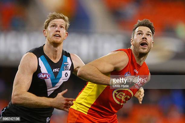 Matthew Lobbe of the Power and Keegan Brooksby of the Suns compete for the ball during the round 23 AFL match between the Gold Coast Suns and the...