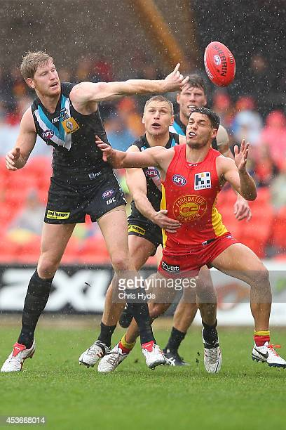 Matthew Lobe of the Power and Dion Prestia of the Suns compete for the ball during the round 21 AFL match between the Gold Coast Suns and the Port...