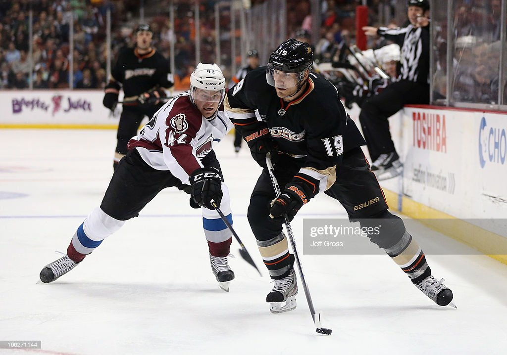 <a gi-track='captionPersonalityLinkClicked' href=/galleries/search?phrase=Matthew+Lombardi&family=editorial&specificpeople=203305 ng-click='$event.stopPropagation()'>Matthew Lombardi</a> #19 of the Anaheim Ducks is pursued by Brad Malone #42 of the Colorado Avalanche for the puck in the third period at Honda Center on April 10, 2013 in Anaheim, California. The Avalanche defeated the Ducks 4-1.