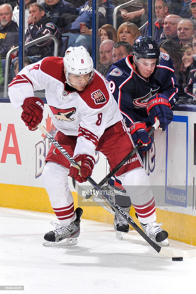 Matthew Lombardi #8 of the Phoenix Coyotes and Ryan Johansen #19 of the Columbus Blue Jackets battle for the puck in the third period on March 16, 2013 at Nationwide Arena in Columbus, Ohio. Columbus defeated Phoenix 1-0 in a shootout.