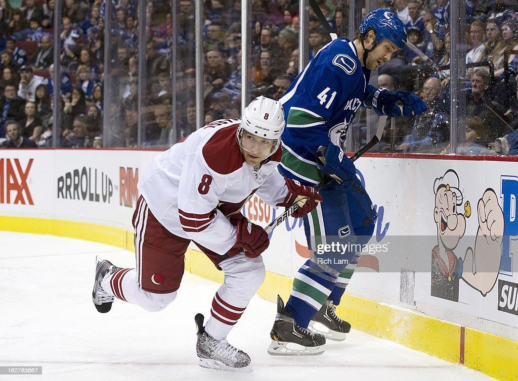 Matthew Lombardi #8 of the Phoenix Coyotes has his stick help by Andrew Alberts #41 of the Vancouver Canucks during the third period in NHL action on February 26, 2013 at Rogers Arena in Vancouver, British Columbia, Canada.