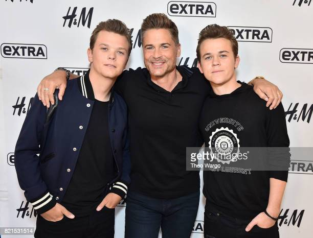 Matthew Lowe Rob Lowe and John Owen Lowe Visit 'Extra' at HM in Times Square on July 24 2017 in New York City