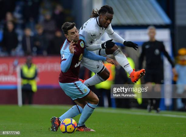 Matthew Lowton of Burnley and Renato Sanches of Swansea City challenge during the Premier League match between Burnley and Swansea City at Turf Moor...