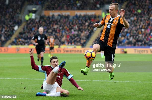 Matthew Lowton of Burnley attempts to clear the ball while Kamil Grosicki of Hull City puts him under pressure during the Premier League match...