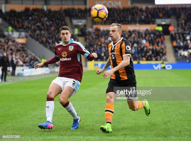 Matthew Lowton of Burnley is put under pressure from Kamil Grosicki of Hull City during the Premier League match between Hull City and Burnley at...
