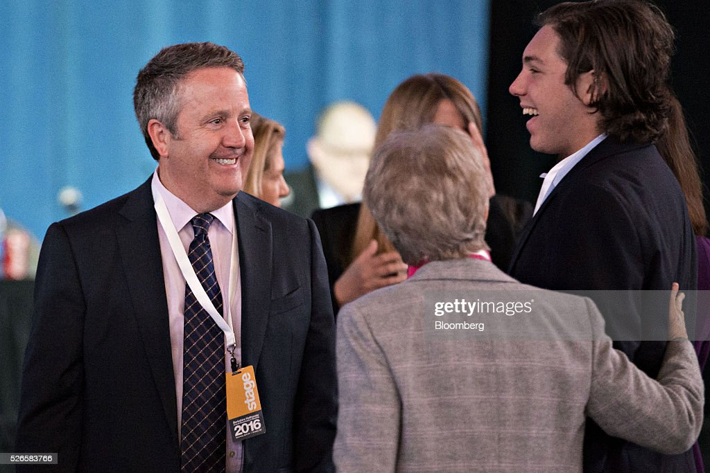 Matthew 'Matt' Rose, chairman and chief executive officer of Burlington Northern Santa Fe (BNSF), left, greets attendees ahead of the Berkshire Hathaway Inc. annual shareholders meeting in Omaha, Nebraska, U.S., on Saturday, April 30, 2016. Dozens of Berkshire Hathaway Inc. subsidiaries will be showing off their products as Chief Executive Officer Warren Buffett hosts the company's annual meeting. Photographer: Daniel Acker/Bloomberg via Getty Images