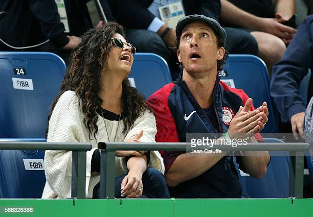 Matthew McConaughey and his wife Camila Alves cheer for Team USA during the men's basketball match between USA and Australia on day 5 of Rio 2016...