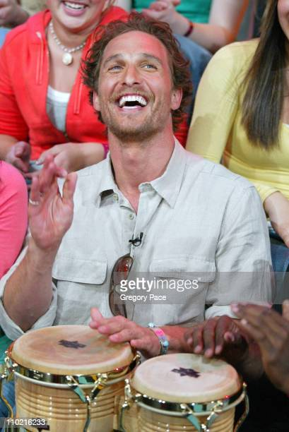 Matthew McConaughey playing the bongos with TRL audience members
