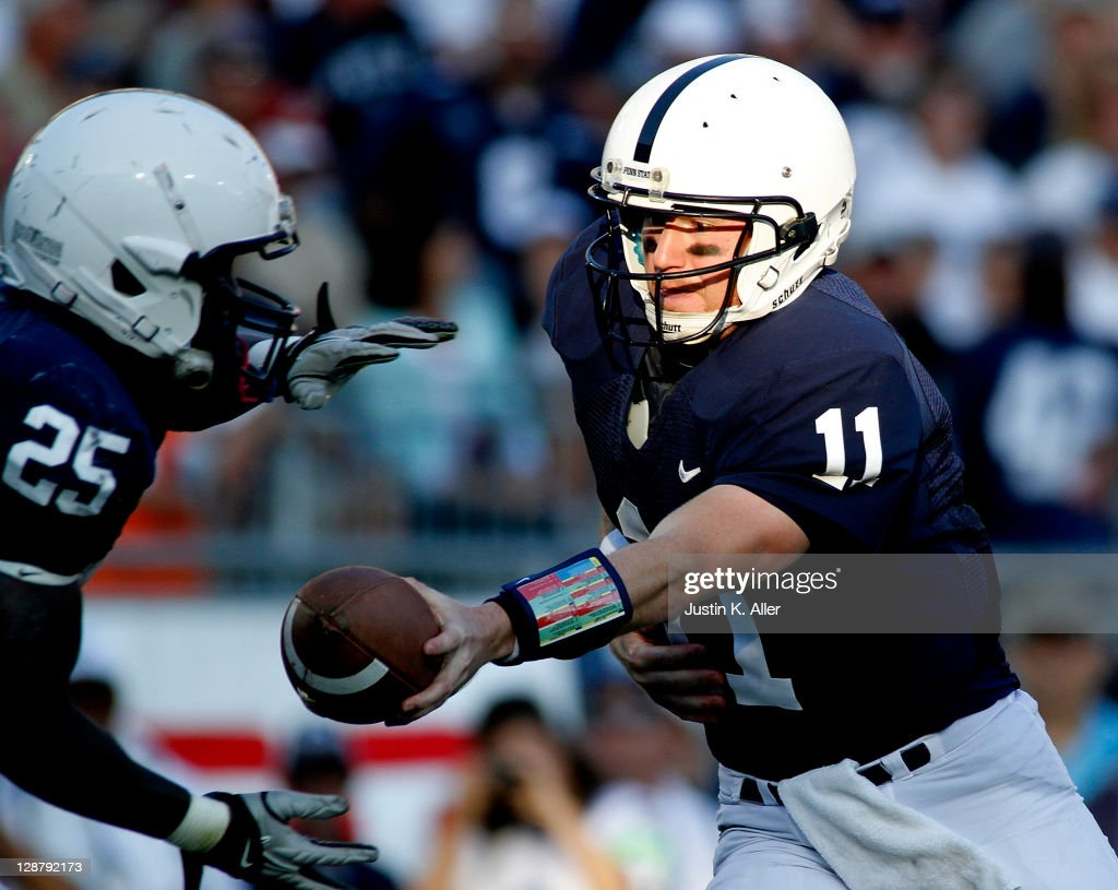Matthew McGloin #11 of the Penn State Nittany Lions hands the ball off to Silas Redd #25 against the Iowa Hawkeyes during the game on October 8, 2011 at Beaver Stadium in State College, Pennsylvania. The Lions defeated the Hawkeyes 13-3.