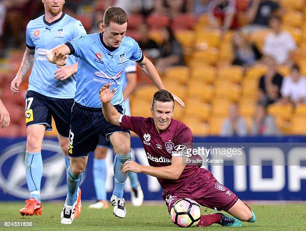 Matthew McKay of the Roar and Brandon O'Neill of Sydney challenge for the ball during the round seven ALeague match between the Brisbane Roar and...