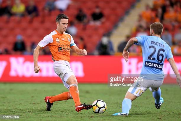 Matthew McKay of the Roar looks to take on the defence of Luke Brattan of Melbourne City during the round seven ALeague match between Brisbane Roar...