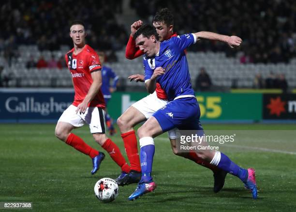 Matthew Millar of South Melbourne is pressured by Ayden Brice of Edgeworth Eagles during the FFA Cup round of 32 match between South Melbourne and...