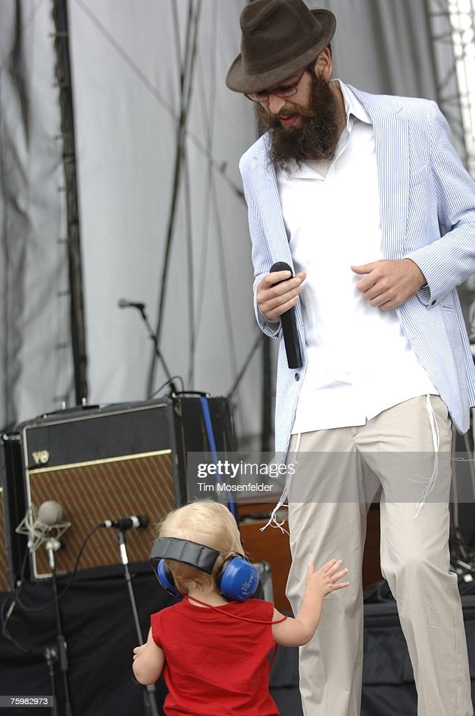 Matthew Miller, who goes by the stage name Matisyahu, and a young fan dance during a performance at the Virgin Festival at Pimlico Racetrack on August 5, 2007 in Baltimore, Maryland.