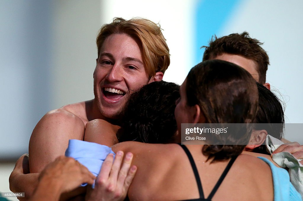 Matthew Mitcham of Australia congratulates Esther Qin (unsighted) on her victory in the Women's 3m Springboard Final at the Royal Commonwealth Pool during day ten of the Glasgow 2014 Commonwealth Games on August 2, 2014 in Edinburgh, United Kingdom.