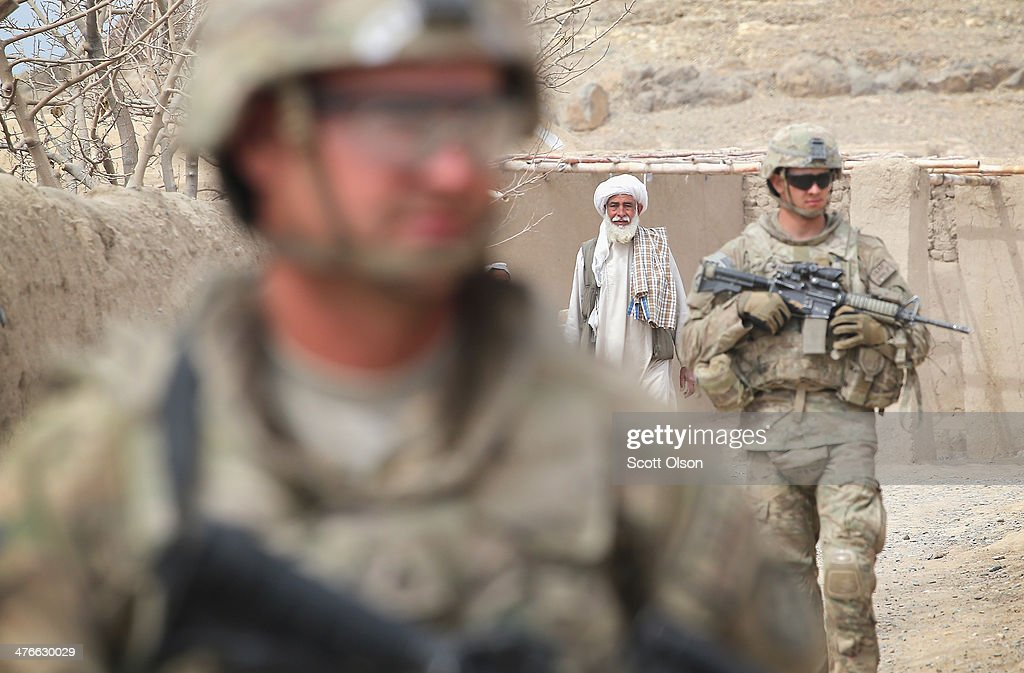 CPL Matthew Moebes (L) from Decator, Alabama and SPC Scott Harris with the U.S. Army's 4th squadron 2d Cavalry Regiment participate in a joint patrol through a village with soldiers from the Afghan National Army (ANA) March 4, 2014 near Kandahar, Afghanistan. President Obama recently ordered the Pentagon to begin contingency planning for a pullout from Afghanistan by the end of 2014 if Afghanistan President Hamid Karzai or his successor refuses to sign the Bilateral Security Agreement.