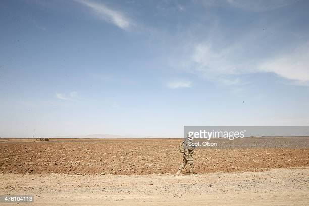 Matthew Moebes from Decator Alabama with the US Army's 4th squadron 2d Cavalry Regiment walks toward a village during a joint patrol with soldiers...
