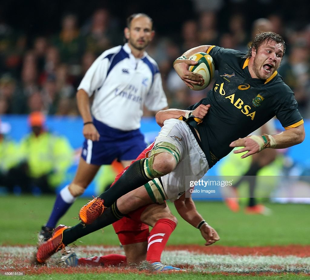 Matthew Morgan of the Wales making a tackle on Duane Vermeulen of South Africa during the Incoming Tour match between South Africa and Wales at Growthpoint Kings Park on June 14, 2014 in Durban, South Africa.