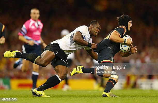 Matthew Morgan of Wales is tackled by Vereniki Goneva of Fiji during the 2015 Rugby World Cup Pool A match between Wales and Fiji at the Millennium...