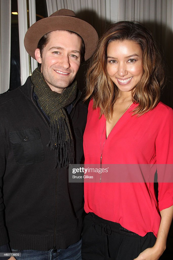 Matthew Morrison and wife Renee Puente Morrison pose backstage at the hit musical 'Motown' on Broadway at The LuntFontanne Theater on December 21...